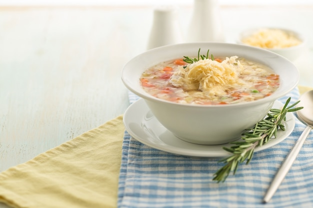 Vegetable soup with cheese and fresh herbs
