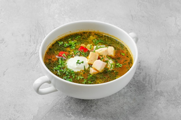 Vegetable soup with chicken fillet and sour cream
