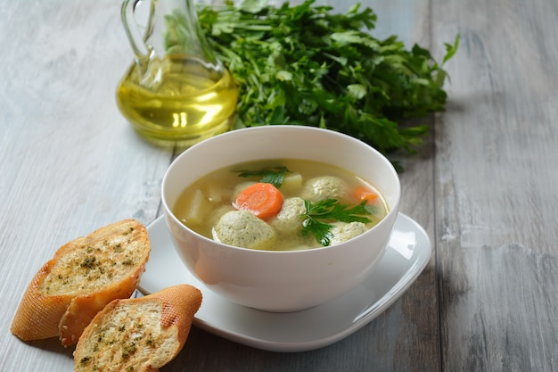 Vegetable soup with chicken meatballs in a bowl