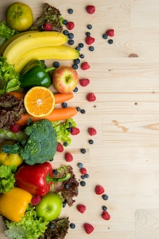 Vegetables and fruits on wood table, Healthy food concept