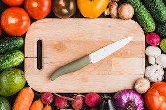 Vegetables around cutting board