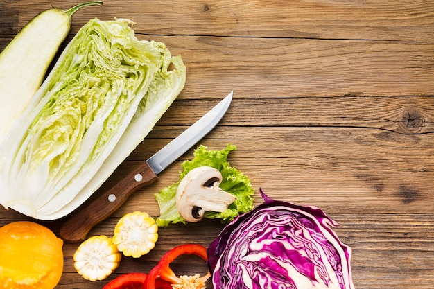 Vegetables arrangement on wooden background with copy space