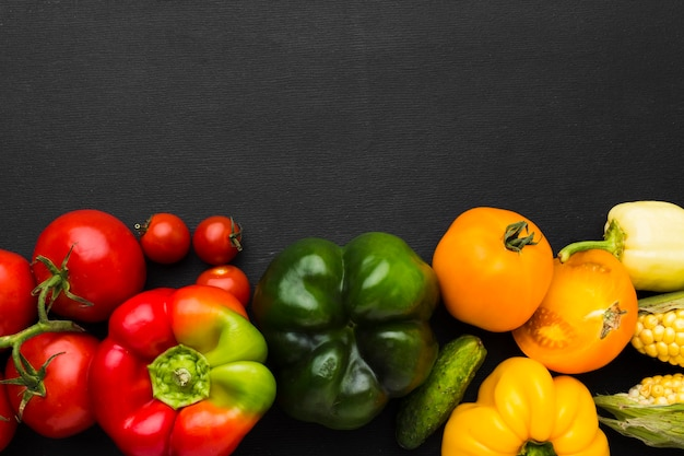 Vegetables assortment on dark background with copy space