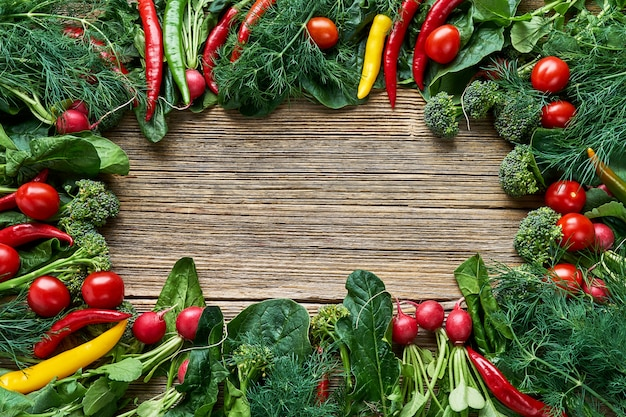 Vegetables background. radish, broccoli, spinach leaves with copy space in the middle. top view. organic food. healthy food background.