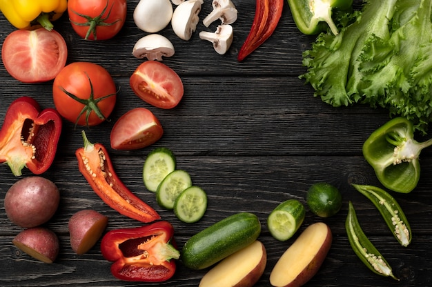 Vegetables on a black wooden table. top view with copy space