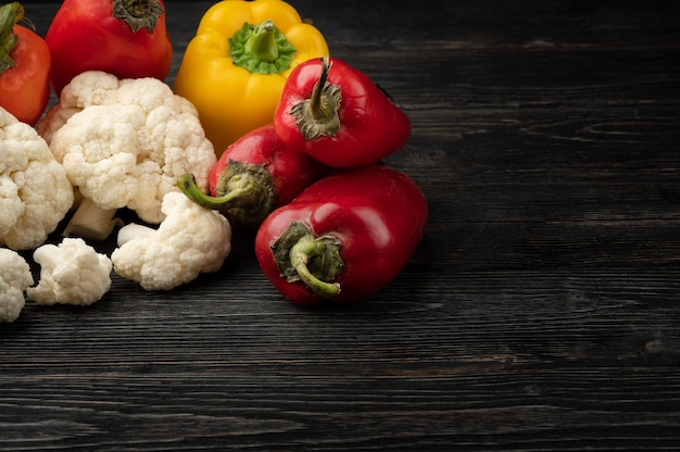 Vegetables on a dark wooden background with copy space and top view