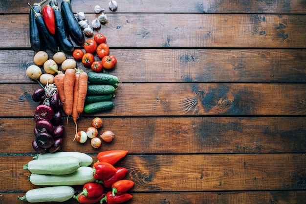 Vegetables of different colors on a dark textured background with copyspace