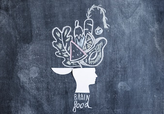 Vegetables drawn over the open head on chalkboard