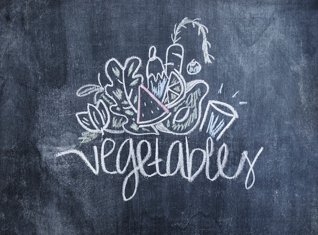 Vegetables drawn with chalk on blackboard