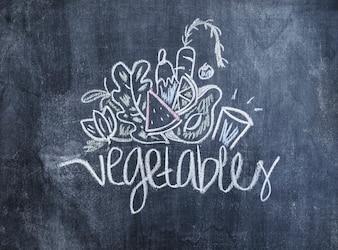 Vegetables drawn with chalk on blackboard