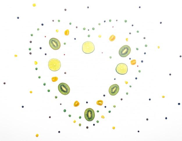Vegetables and fruit detox in heart shape on white background