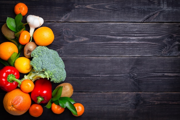 Vegetables and fruits to maintain immunity on a black background. copy space