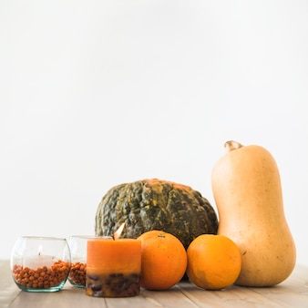 Vegetables and fruits near candle