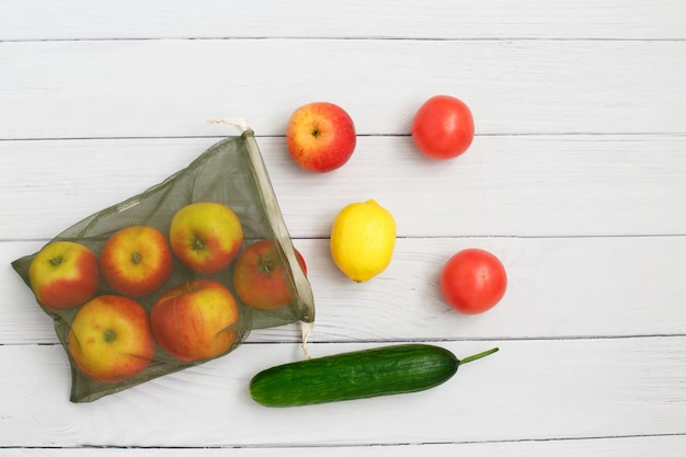 Vegetables and fruits on reusable eco friendly mesh bag