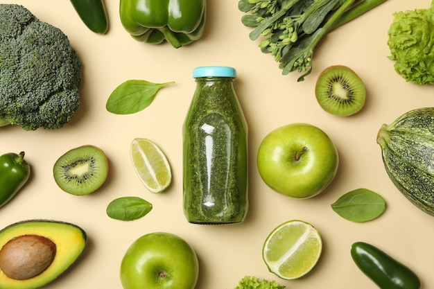 Vegetables, fruits and smoothie on beige background