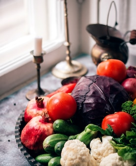 Vegetables and herbs with pomegranate