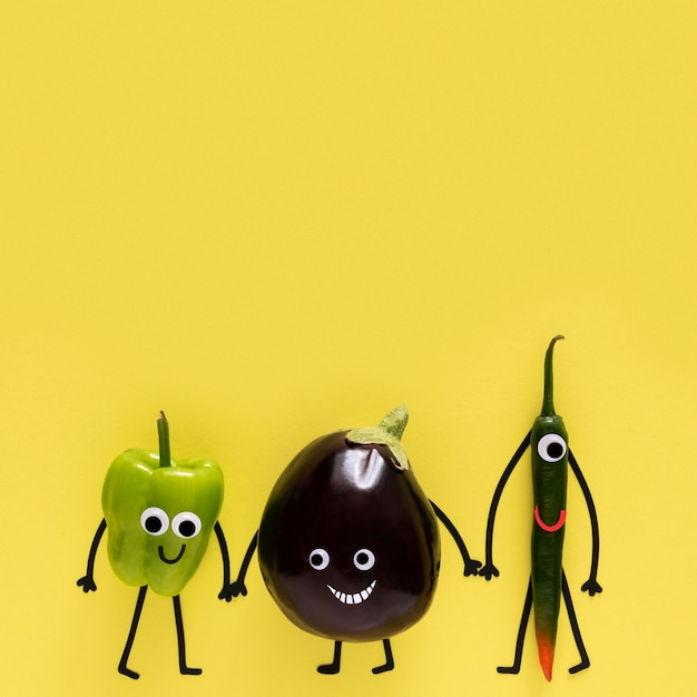 Vegetables holding hands with copy space