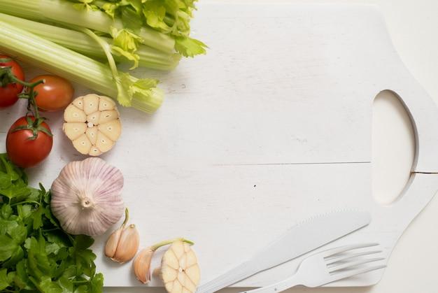 Vegetables ingredients. celery parsley and garlic.preparing food, healthy eating. copy space top view