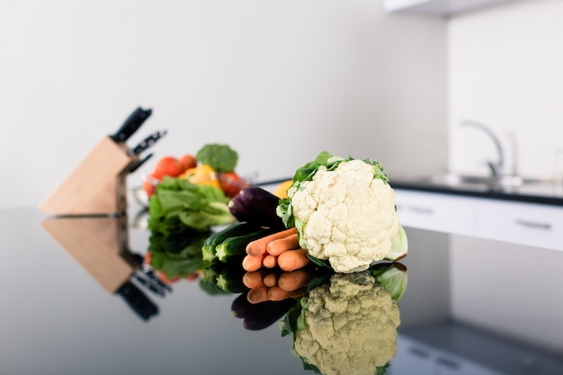 Vegetables on kitchen counter in stylish apartment