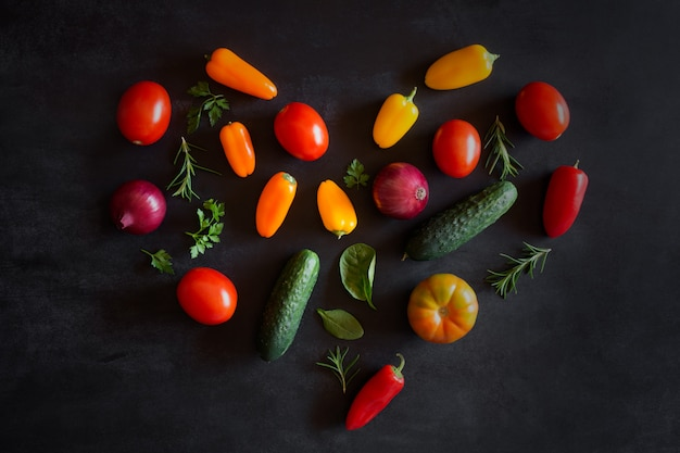 Vegetables laid out in the shape of heart. top view