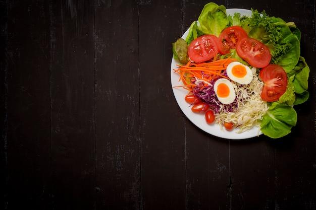 Vegetables salad on black  wooden  background