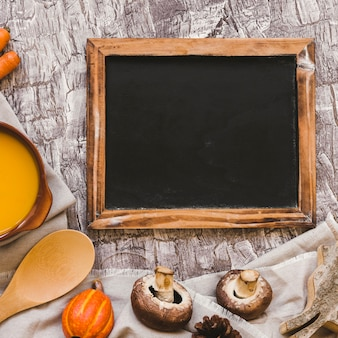 Vegetables and soup near chalkboard