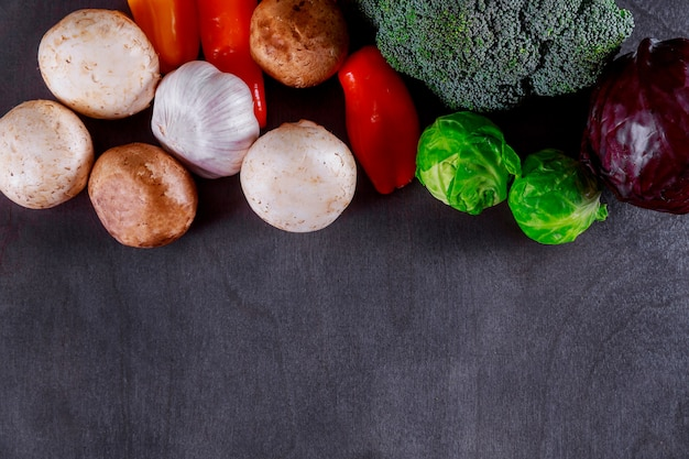 Vegetables on wood background autumn harvest. rural still life from above free text space.