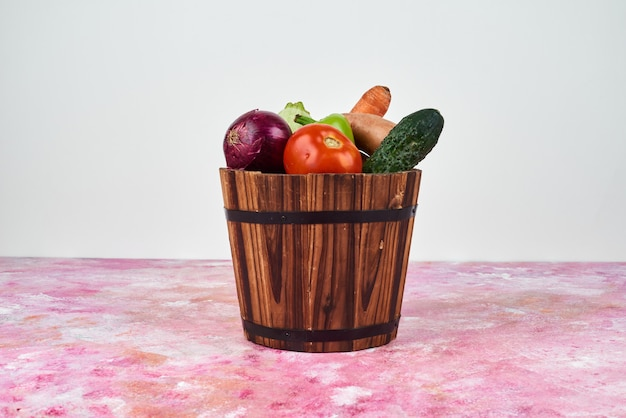 Vegetables in a wooden bucket.
