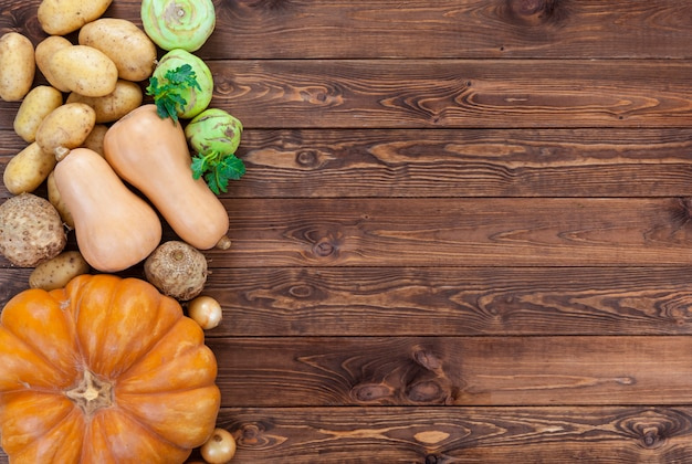 Vegetables on wooden. pumpkin, zucchini, potatoes, onions and other vegetables