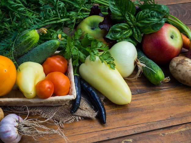 Vegetables on a wooden table. bio healthy food, herbs and vegetables from farm plantations. Premium Photo