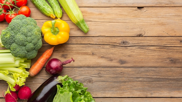 Vegetables on wooden table flat lay