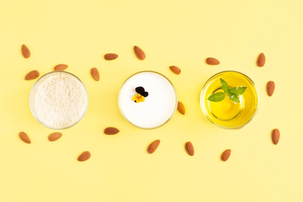 ベジタリアンアーモンド製品の小麦粉、バター、牛乳は黄色のグラスに入っています。