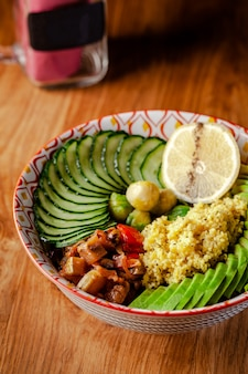 Vegetarian bowl for breakfast of porridge couscous.