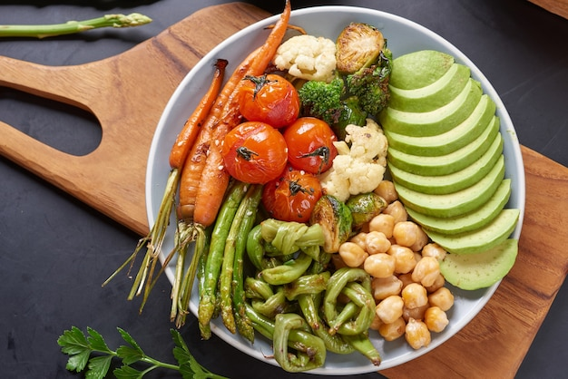 Vegetarian buddha bowl with fresh vegetable salad and chickpea.