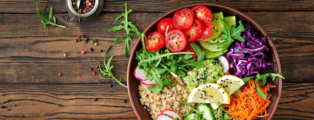 Vegetarian buddha bowl with quinoa and fresh vegetables. healthy food concept. vegan salad. top view. flat lay.