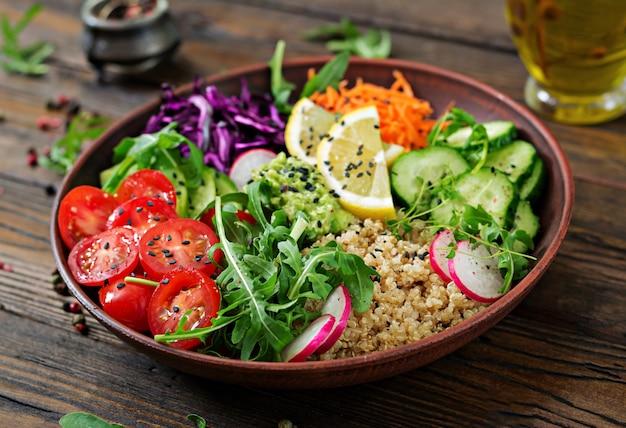 Vegetarian buddha bowl with quinoa and fresh vegetables. healthy food concept. vegan salad.
