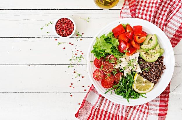 Vegetarian buddha bowl with quinoa, tofu cheese and fresh vegetables.  vegan salad