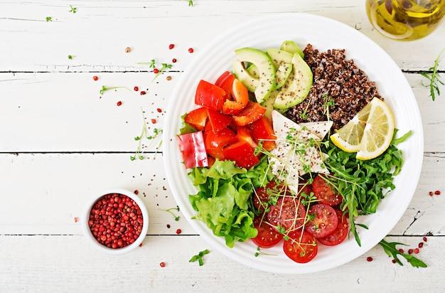 Vegetarian buddha bowl with quinoa, tofu cheese and fresh vegetables. vegan salad.