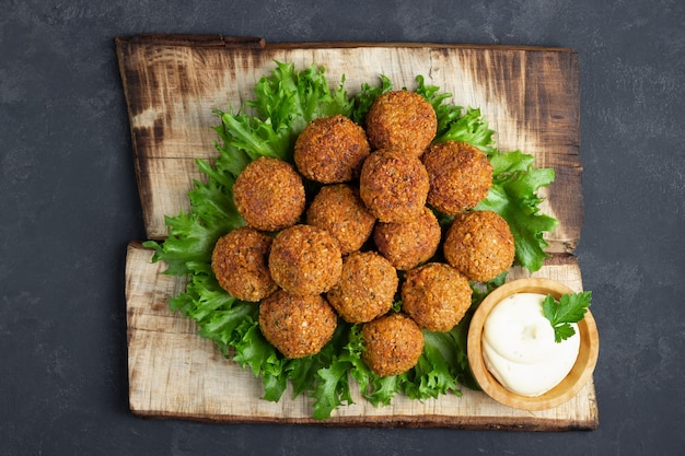Vegetarian chickpeas falafel balls on wooden rustic board