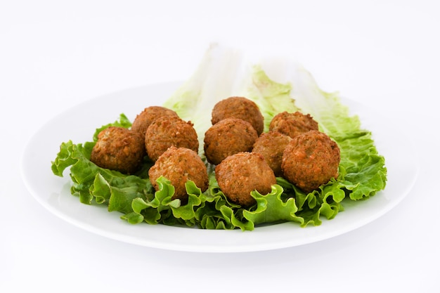 Vegetarian falafels and lettuce isolated on white