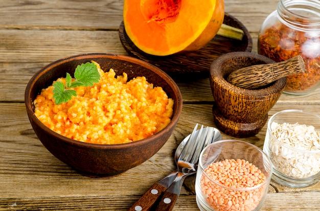 Vegetarian food, porridge with pumpkin and lentils.