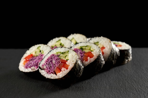Vegetarian maki filled with cucumber or kappa, red paprika and violet cabbage.
