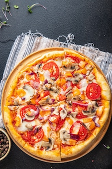 Vegetarian pizza vegetable tomato pepper onion mushroom corn fresh portion ready to eat meal