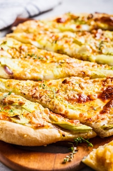 Vegetarian pizza with zucchini, cheese and nuts