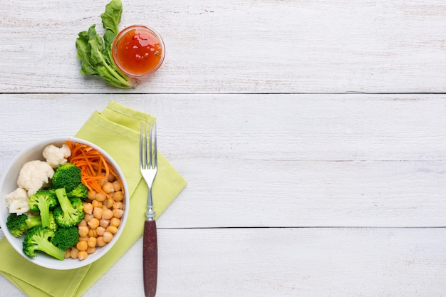 Vegetarian poke bowl with chickpeas, broccoli, cauliflower and carrots