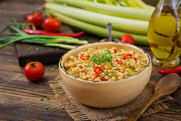 Vegetarian porridge from turkish couscous with vegetables. dietary menu. vegan cuisine.