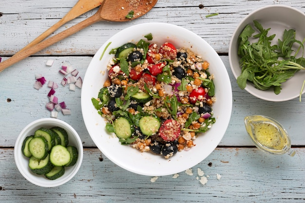 Vegetarian salad quinoa, tomatoes, cucumbers, chickpeas, olives, herbs, cottage cheese