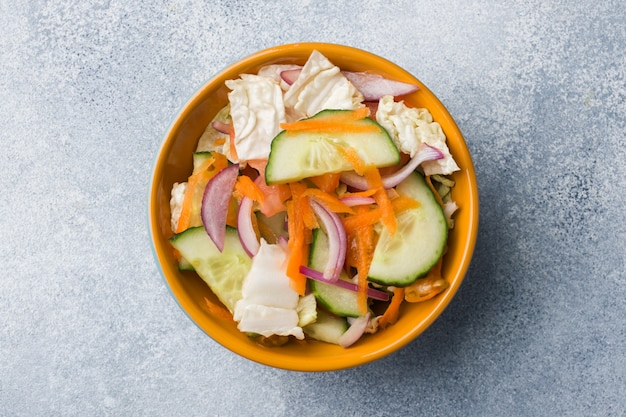 Vegetarian salad of raw fresh vegetables in a plate