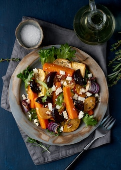 Vegetarian salad ricotta cheese, baked roasted vegetables, keto ketogenic dash diet.