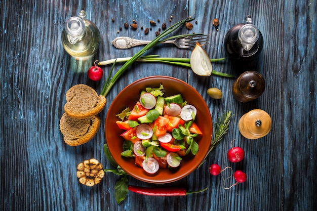 Vegetarian salad on rustic wooden background